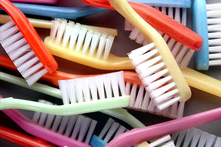 Set of multicolor toothbrushes photo