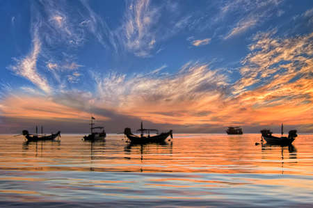 Sunset with longtail boats on tropical beach  Ko Tao island, Thailand  photo