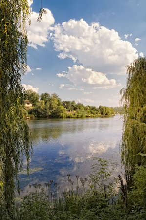 Landscape with trees, reflecting in the water Stock Photo - 14588166