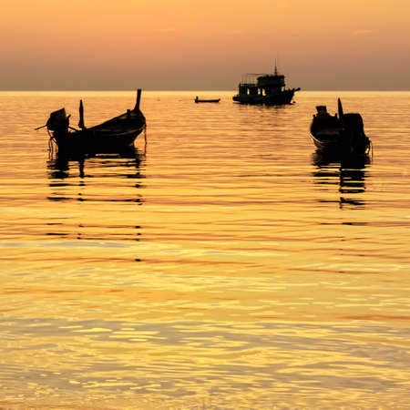 longtail: Gold sunset with longtail boats on tropical beach  Ko Tao island, Thailand