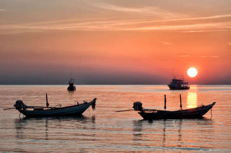 long tailed boat: Long tailed boat Ruea Hang Yao at sunset in Krabi Thailand. Stock Photo