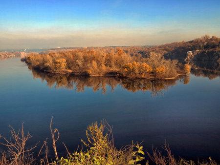 Scenic view of autumn island and river. Ukraine