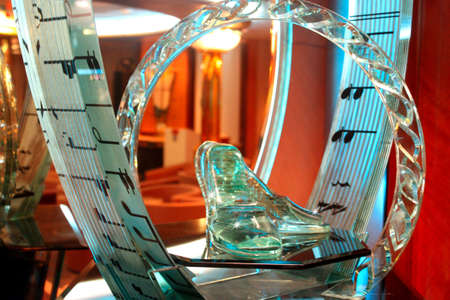 A pair of glass Cinderella shoes on a glass stand Editorial