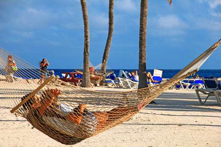 A couple relaxing in a hammock in Bahamas