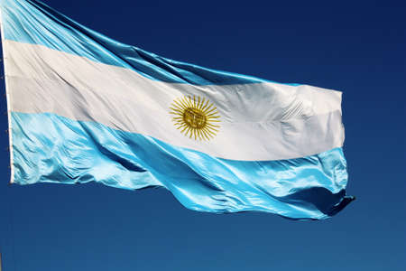 Argentinian flag against the blue sky