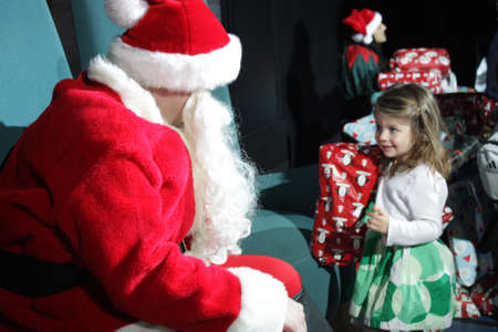 December 26, 2010 - RCCL, Mariner of the Seas : Santa is giving presents to the children on an early Christmas morning