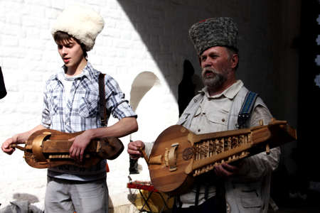 11 June 2011, Moscow, Russia: musicians playing the old  historical russian instruments to entertain the public