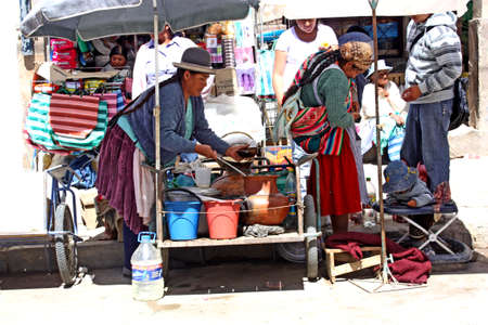 5 April, 2010 - La Quiaca, Bolivia - A Bolivian chola selling her self-cooked food on a local market