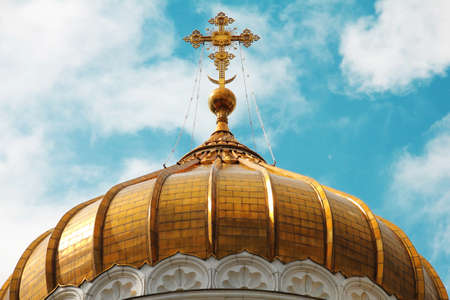 The cupola of the temple of Christ the Savior against the blue cloudy sky