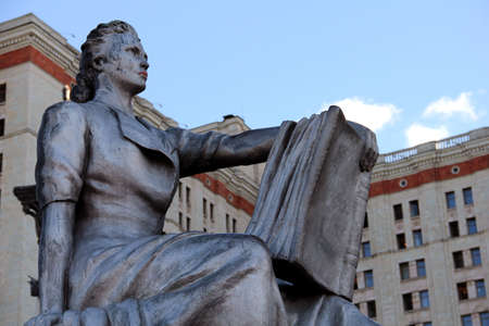 The statue of a studing female student in front of the Moscow University  Stock Photo