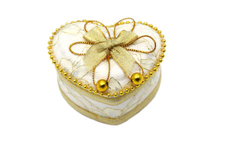 Gold Heart Shaped Jewel Box close up on white background.