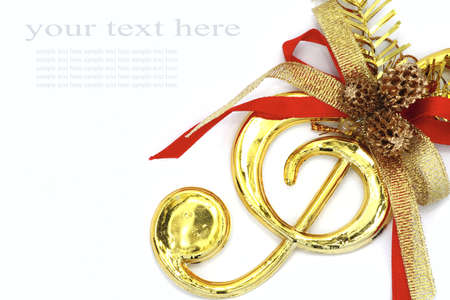 Christmas with musical signs and color ribbon on white background. photo