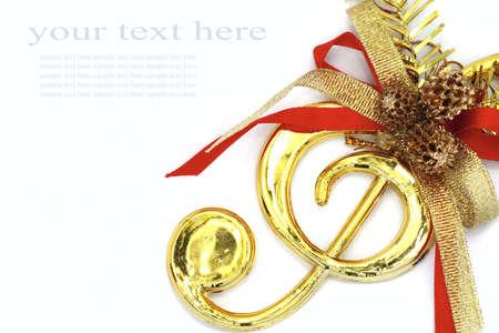 niño cantando: Navidad con los signos musicales y cintas de colores sobre fondo blanco. Foto de archivo