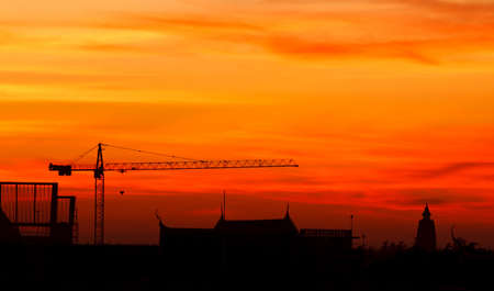Industrial construction cranes and building at sunrise Stock Photo - 13460063