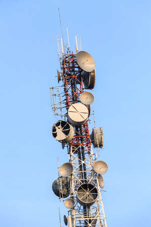 Telecommunications tower with several kind of antennas  photo