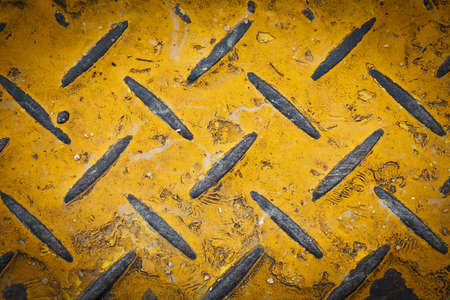 Steel floor plate paint with yellow pattern photo