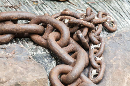 Pile of rusted old chains at a boatyard. Stock Photo - 14263684