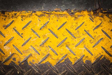 Dark steel floor plate paint with yellow pattern photo