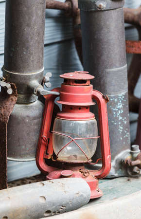 Old lamp, Hurricane lampstorm lantern; very corroded vintage kerosene lamp; photo