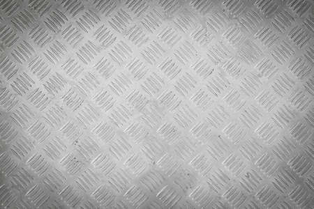 Background of metal diamond plate pattern. photo