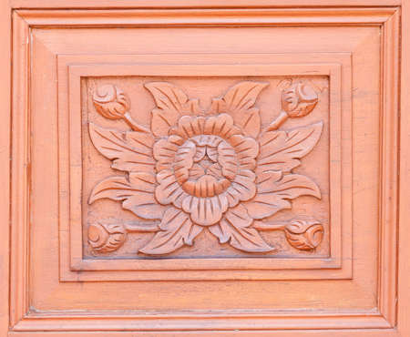 Carved pattern on wood, element of decor photo
