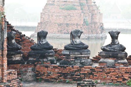 Buddha statues and Floods Chaiwatthanaram Temple at Ayutthaya, Thailand photo