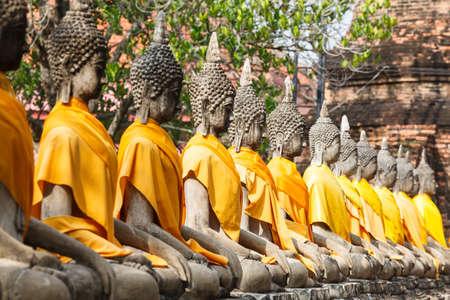 far eastern: Buddha statues at the temple of Wat Yai Chai Mongkol in Ayutthaya near Bangkok, Thailand Stock Photo