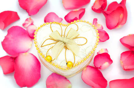 Heart cup and rose petals photo