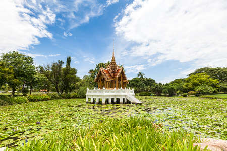 Thai temple on the water at Rama 9 Garden Bangkok, Thailand photo