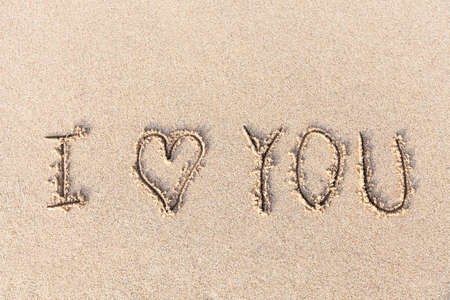 I love you handwritten in sand for natural, love,tourism or conceptual designs photo