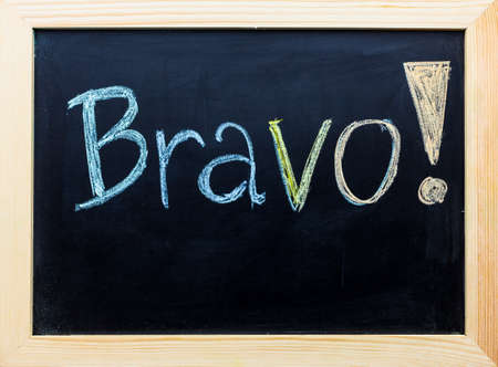 Bravo word on black board.
