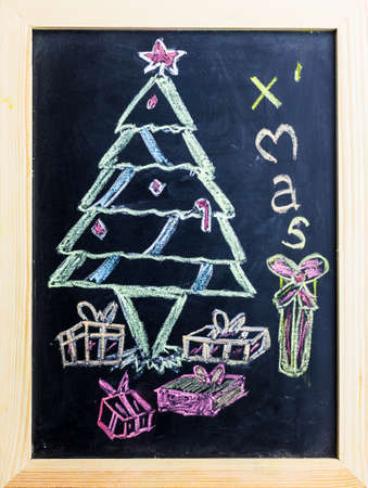 Christmas tree draw on black board. photo