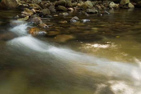 tides: tides and river at waterfall,Yong waterfall,Nakhorn Sritummarat,Thailand Stock Photo