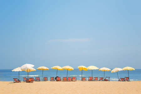 umbella: Many chairs on Golden Beach and blue sea and sky.