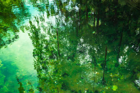 sky reflection: green hotspring well and sky reflection Stock Photo