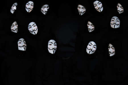 guy fawkes: Anonymous Mask or Anonymous Face on Black Background