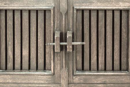 locked: woodned locked door (locked by wooden key stick) Stock Photo