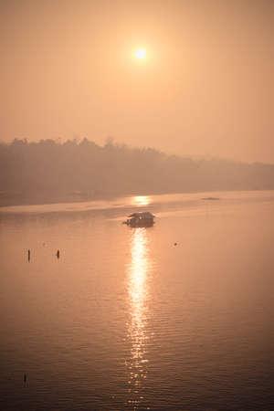 landscape mode: houseboat on river at sangkalburi, Kanchanaburi, Thailand Stock Photo