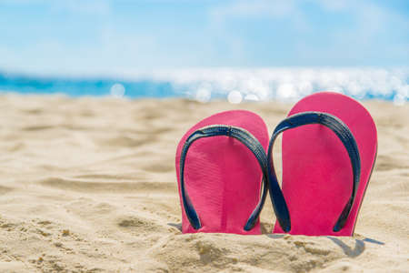 Red shoe on the beach,go to travel concept
