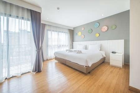 modern bedroom: interior of white cozy bedroom (modern bedroom) Stock Photo