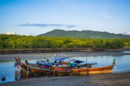 Wooden fisherman boats on river in Thailand.