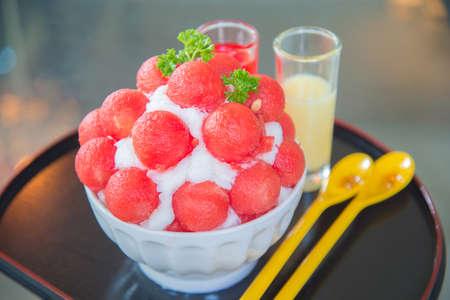 watermelon bingsu dessert with milk and watermelon syrup. Фото со стока