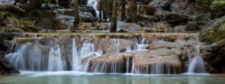 beautiful waterfall panorama in forest. Фото со стока