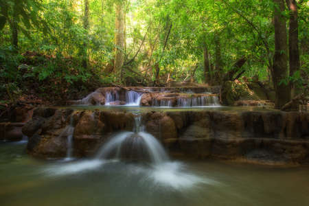 dreammy waterfall with sunlight in forest. Фото со стока