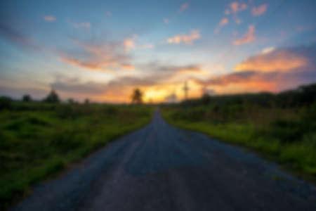 Blurred road to sunset. Фото со стока