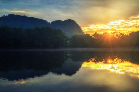 reflection of sunlight and lake in Thailand.