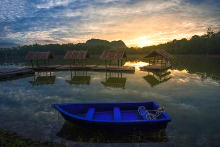 Blue boat on beautiful  lake.
