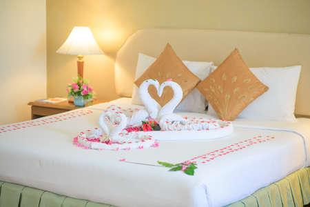 Swan towel on honeymoon bed