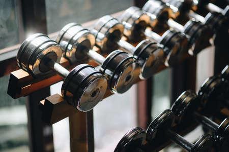 Dumbells in fitness room.