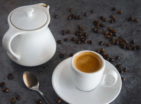 hot espresso coffee and coffee bean on loft table